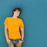 Young man on blue background Royalty Free Stock Photography