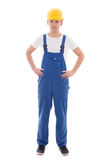 Young man in blue builder uniform isolated on white Royalty Free Stock Photos