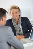 Young man with blue jacket meeting banker Royalty Free Stock Photo