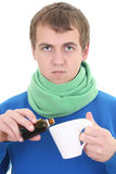 Young man in blue with medicine and cup Royalty Free Stock Photography