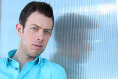 A Young Man in a Blue Shirt Stock Image