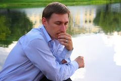 A young man in a blue shirt Royalty Free Stock Images