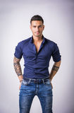 Young man in blue shirt and jeans  Royalty Free Stock Images