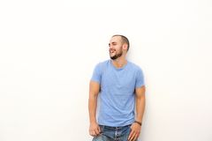 Young man with blue shirt laughing Royalty Free Stock Photos