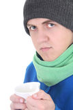 young man in blue sweater and green scarf with cu Stock Photo