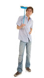 Young man with blue sweep brush Stock Images