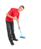 Young man with blue sweep brush Stock Photo