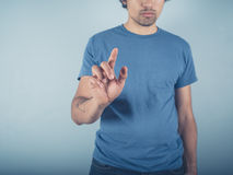 Young man in blue swiping stock image