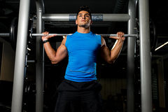 Young man in Blue T-Shirt doing Barbell Squat Stock Photography