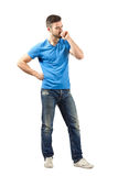 Young man in blue t-shirt thinking looking down Royalty Free Stock Images