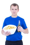 Young man in blue uniform watching tv with beer and chips isolat Stock Photo