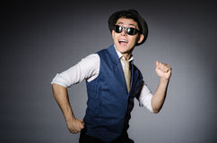 Young man in blue vest and hat against gray Royalty Free Stock Image