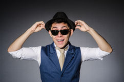 Young man in blue vest and hat against gray Royalty Free Stock Images