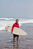 Young man with a board for surf on an ocean coast Royalty Free Stock Images