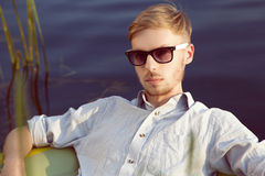 Young man in a boart Royalty Free Stock Images
