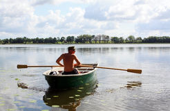 Young man on the boat Royalty Free Stock Images