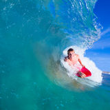 Young man body boarding. Youthful young man Boogie Boarding Blue Wave royalty free stock photo