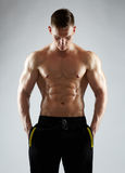 Young man or bodybuilder with bare torso Royalty Free Stock Photo