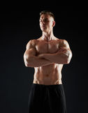 Young man or bodybuilder with bare torso Stock Photography