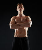 Young man or bodybuilder with bare torso Royalty Free Stock Photography