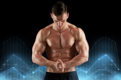 Young man or bodybuilder with bare torso. Sport, bodybuilding, fitness and people concept - young man or bodybuilder with bare torso over black background and Royalty Free Stock Photography