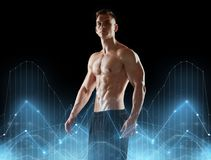 Young man or bodybuilder with bare torso. Sport, bodybuilding, fitness and people concept - young man or bodybuilder with bare torso over black background and Stock Photos
