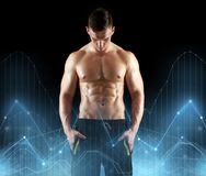Young man or bodybuilder with bare torso. Sport, bodybuilding, fitness and people concept - young man or bodybuilder with bare torso over black background and Royalty Free Stock Photos