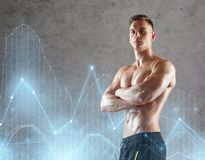 Young man or bodybuilder with bare torso. Sport, bodybuilding, fitness and people concept - young man or bodybuilder with bare torso over concrete background and Stock Images