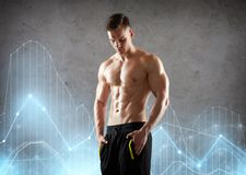 Young man or bodybuilder with bare torso. Sport, bodybuilding, fitness and people concept - young man or bodybuilder with bare torso over gray background with Stock Photos