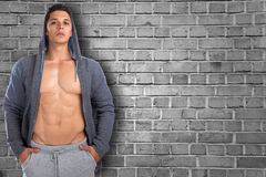 Young man bodybuilder copyspace copy space muscular hoodie bodyb Stock Photo