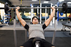 Young man bodybuilder doing weight lifting in gym. Royalty Free Stock Images