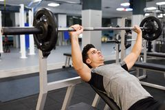 Young man bodybuilder doing weight lifting in gym. Stock Image