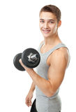 Young man bodybuilder exercising with dumbbells Royalty Free Stock Image