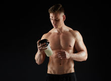 Young man or bodybuilder with protein shake bottle. Sport, bodybuilding, fitness and people concept - young man or bodybuilder with protein shake bottle and bare stock photo