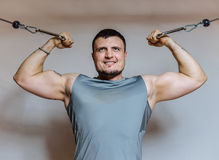 Young Man Bodybuilder Is Working On His Biceps In A Gym Stock Images