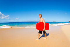 Young Man with Boogie Board Stock Photography