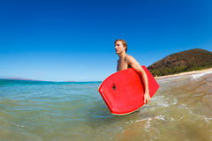 Young Man with Boogie Board Royalty Free Stock Image