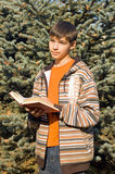 The young man with the book. Has reflected. Park stock image