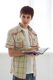 Young man with a book Royalty Free Stock Photography