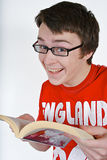 Young man with a book. Handsome young man happy to be reading a good book Stock Photos