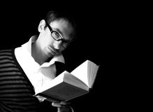 Young man with the book Stock Photos