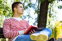 Young man with a book Stock Photo