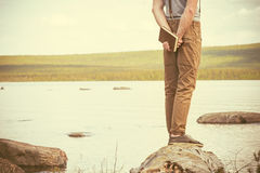 Young Man with book standing outdoor Stock Image