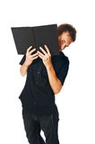 Young man with book on white Royalty Free Stock Photo
