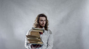 Young man with books Stock Photos