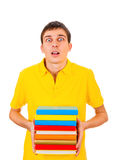 Young Man with a Books. Surprised Young Man with the Books Isolated on the White Background Stock Images