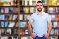 Young man in a bookstore Royalty Free Stock Photography