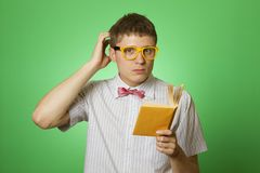 Young man bookworm reading Royalty Free Stock Photo