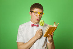 Young man bookworm reading Royalty Free Stock Images