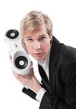 Young man with boombox. Young blond handsome man holding boombox; isolated on white royalty free stock images